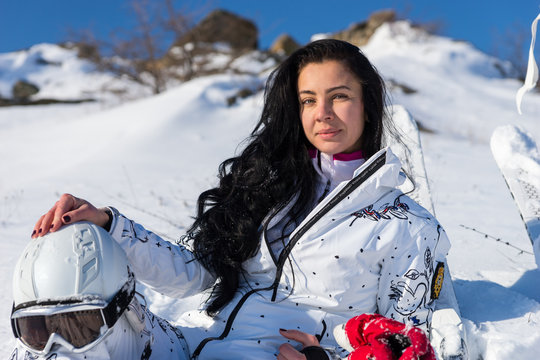 Female Skier with Helmet Enjoying Warm Sunshine