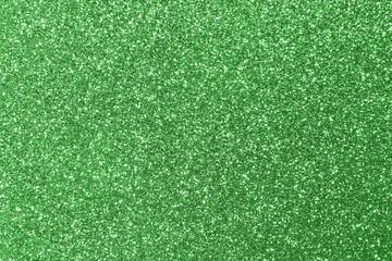 background shining uniformly colored green glitter