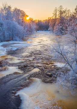 Cold winter river in sunset