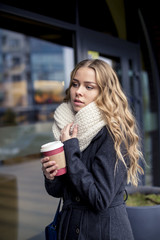 attractive blond woman drinking coffee