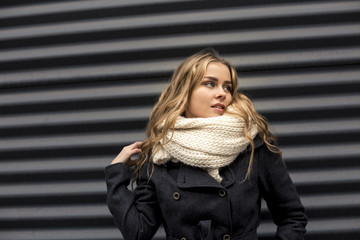 Portrait of an attractive blonde in the street