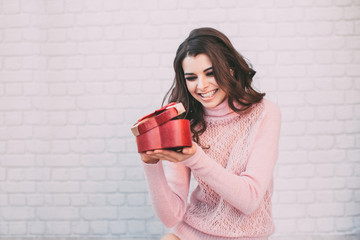 Happy woman opening a gift box.
