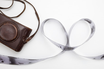 Roll of film, laid out in the shape of a heart and an old vintag