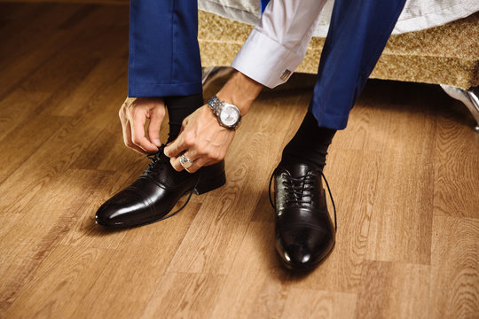 man laces shoes