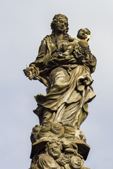 Statue of Madonna and St. Bernard at Charles bridge in Prague