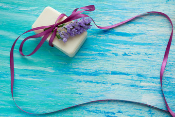 mockup natural organic soap with flowers on  wooden table