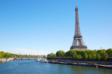Eiffel tower and Seine river in a clear sunny day in Paris