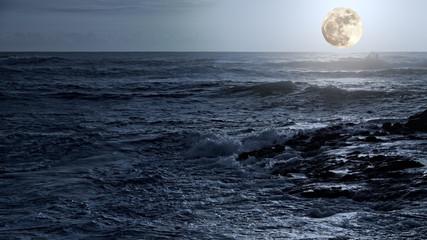 Arising full moon over sea