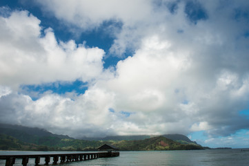 Hanalei Bay pier in Kauai,Hawaii with white clouds in a blue sky