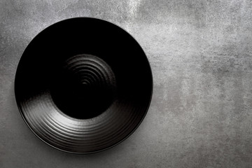Empty Round Black Plate over Slate