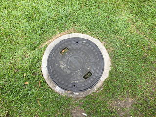 manhole cover on the grass