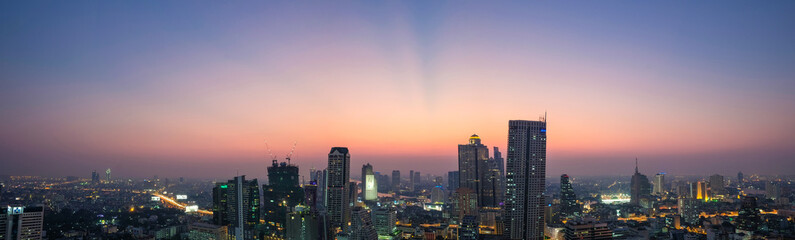 Panoramic view of  Bangkok City at Dust in central business district (CBD) in Bangkok, Thailand with beautiful aurora like sky