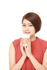 young Japanese woman takes a coffee break