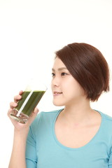 Japanese woman with fresh green vegetable juice
