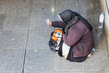 Anonymous female beggar