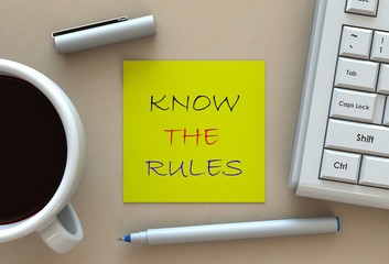 KNOW THE RULES, message on note paper, computer and coffee on table