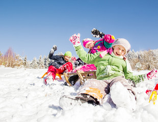 Happy children  at winter time. Group of children spending a nice time in snow