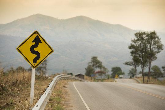 Winding Road Sign on asphalt road