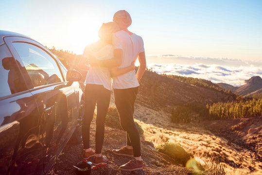 Couple embracing near the car