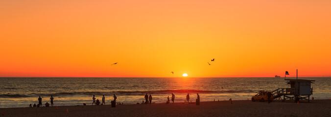Beach at orange sunset, Manhattan Beach, Los Angeles, California
