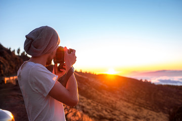 Man photographing sunset