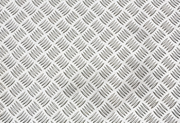 Diamond plate, also known as checker plate, tread plate, cross hatch kick plate and Durbar floor plate, wide shot in landscape orientation.