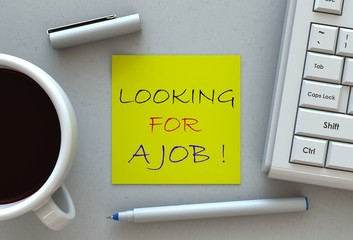 Looking for a job!, message on note paper, computer and coffee on table