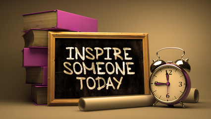 Handwritten Inspire Someone Today on a Chalkboard.