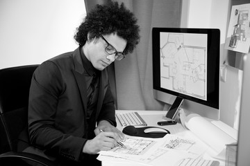 Handsome architect designer at work in office black and white