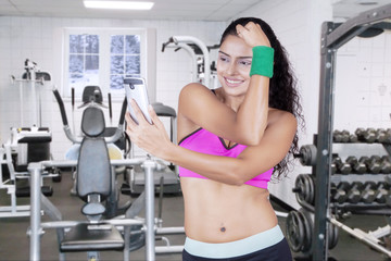 Woman with sportswear taking selfie photo