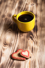 Coffee in cup on wooden table for background