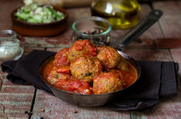 Meatballs with ground pumpkin in tomato sauce