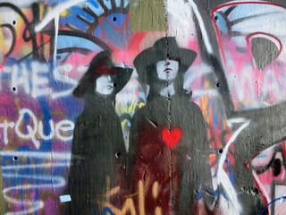Two stencils in love on wall of graffiti - landscape photo