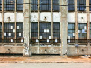 Interesting urban window patterns on abandoned building - landscape photo