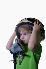 Funny little child in fighter pilot helmet isolated on white background