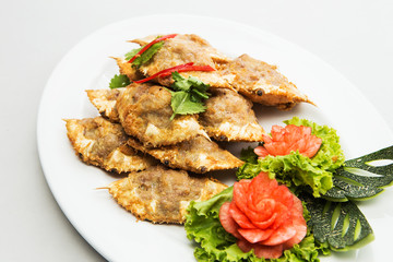 Thai dish made of blue crab whose meat is cooked in its own shel
