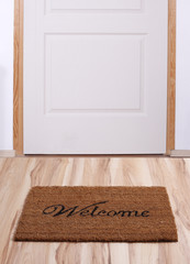 Door with welcome mat