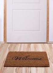 Door with welcome mat