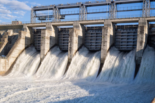 Water rushing out of opened gates of a hydro electric power dam