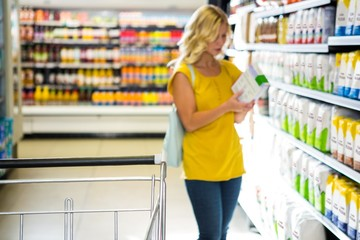 Woman taking a product in aisle