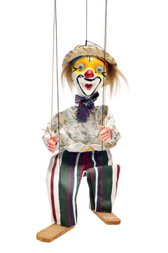 old marionette on a white background