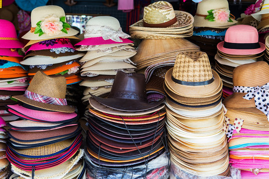 A lot of hats lie on the table