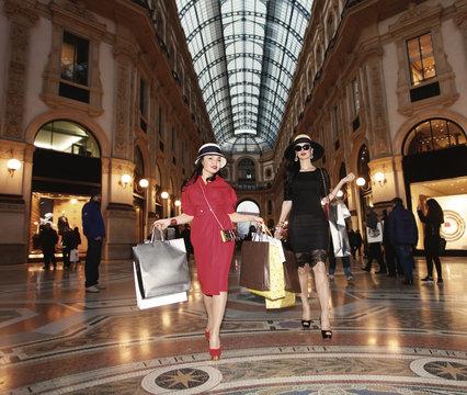 Beautiful shopaholics portrait walking in Milan