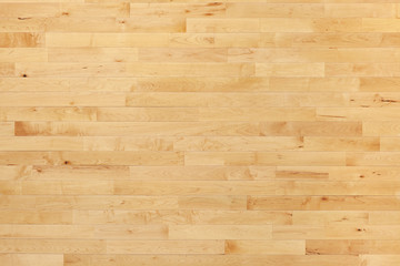 Hardwood basketball court floor viewed from above