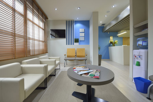 Interior of a modern waiting room. Clinical with empty chairs