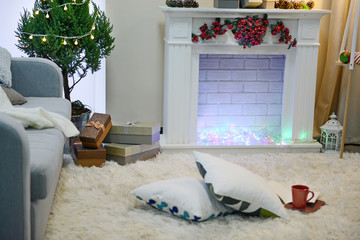Christmas decorated room with fireplace and fir tree