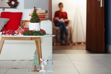 Christmas decoration and girl sitting on the background