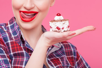 Cheerful young woman is eating tasty food