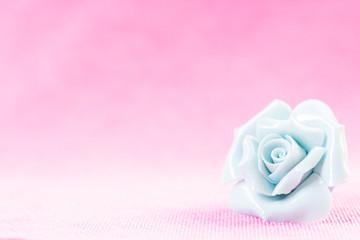 Pastel Rose (Ceramic ) on pink fabic background