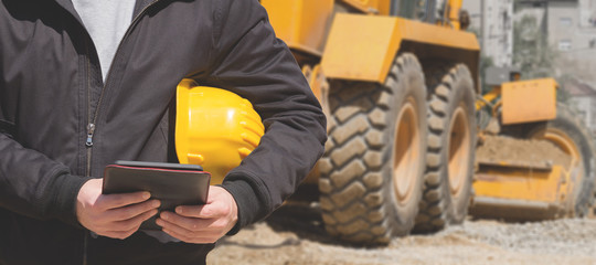 Fototapeta Construction worker using tablet on the site. obraz